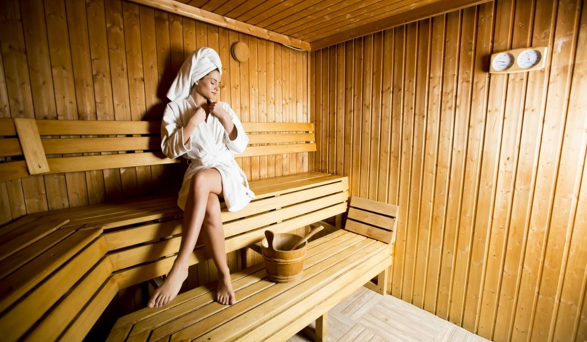 Woman relaxing in the sauna at spa center