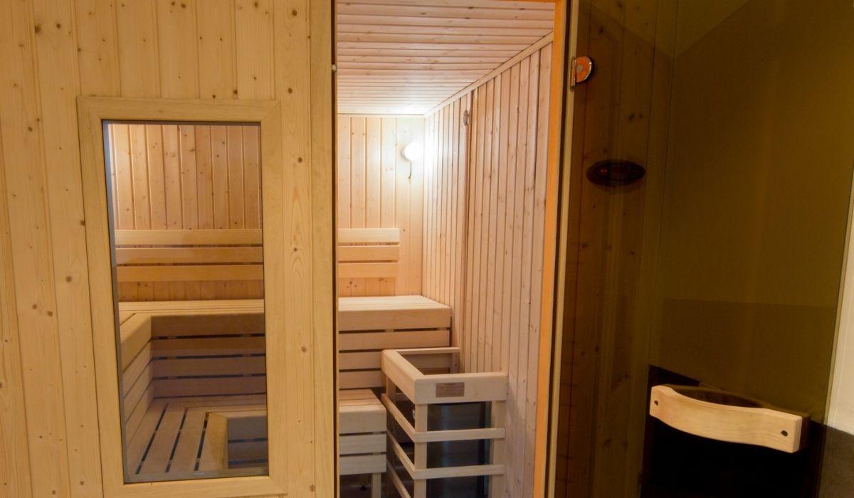 Wooden sauna with glass door