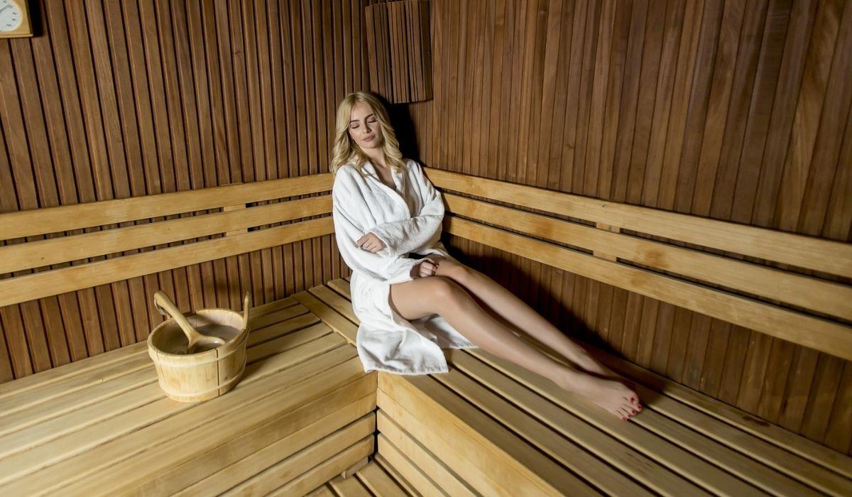 Beautiful blond woman relaxing in a sauna